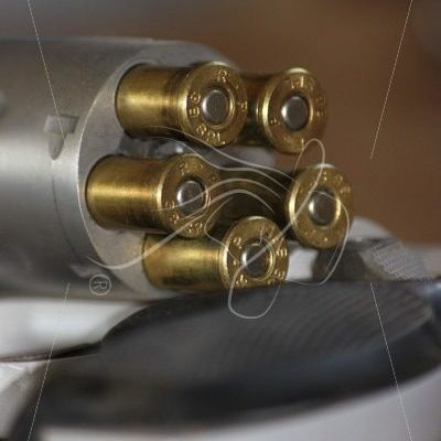 Close up of a revolver with ammunition - Theresa Sheridan Designs