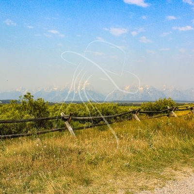 Grand Teton mountains with buck rail fence in foreground - Theresa Sheridan Designs