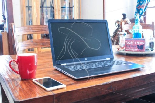 Laptop with red coffee mug and iPhone on wooden table - Theresa Sheridan Designs