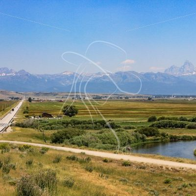 Scenic highway and meadows with Grand Tetons in background - Theresa Sheridan Designs