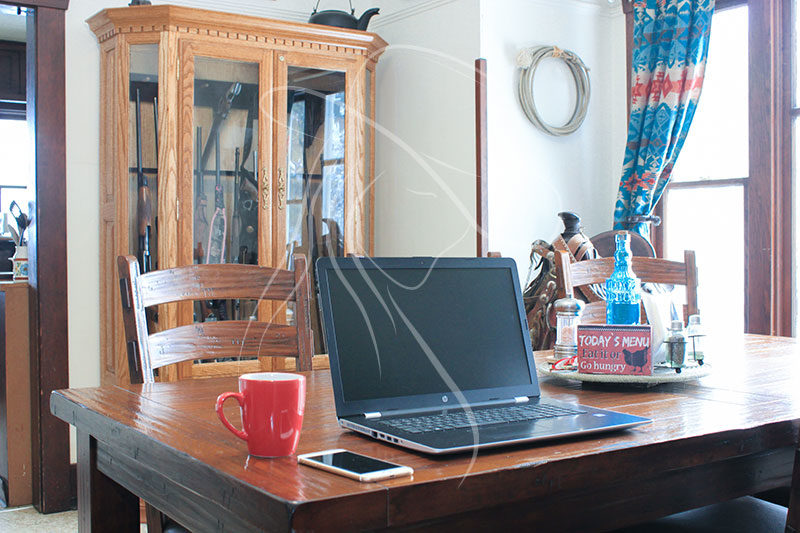 laptop in western dining room styled image
