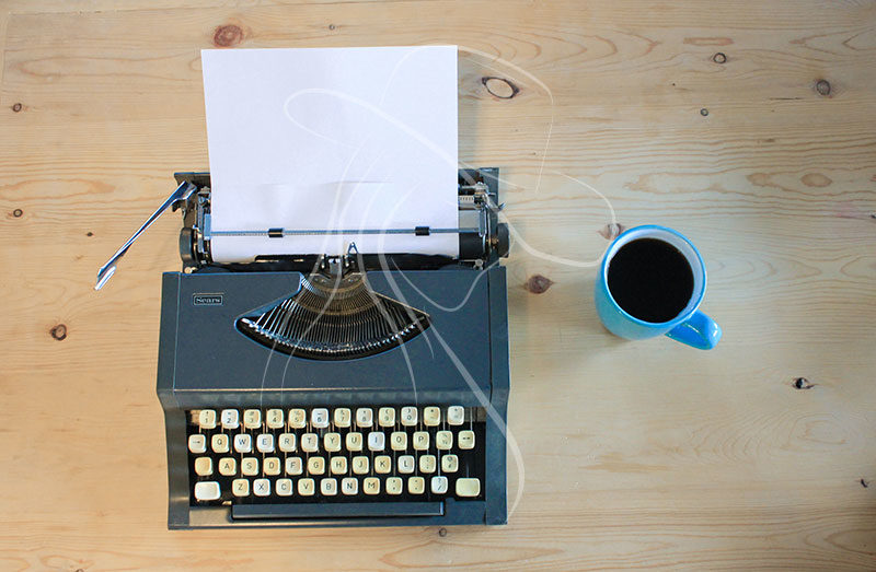 vintage typewriter on wooden table styled image